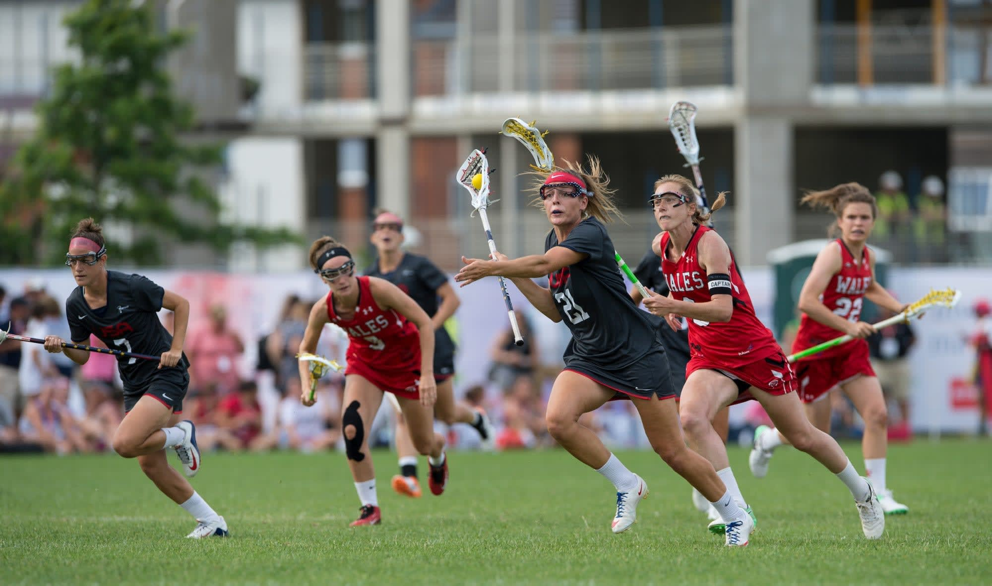 pro women's lacrosse athletes unlimited USA's Taylor Cummings breaks out against Wales at the 2017 FIL Rathbones Women's Lacrosse World Cup, at Surrey Sports Park, Guildford, Surrey, UK, 18th July 2017.