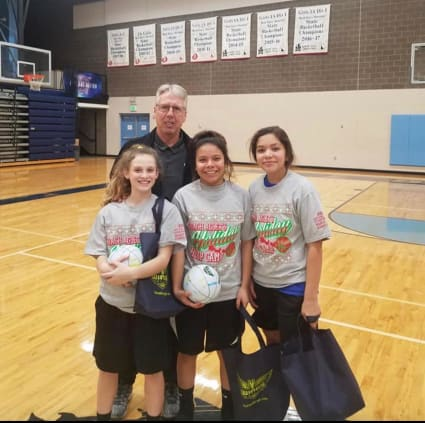 Brian Agler stands with a few of last year's campers as they hold some of their gifts for attending. Photo courtesy of Rika Powaukee.