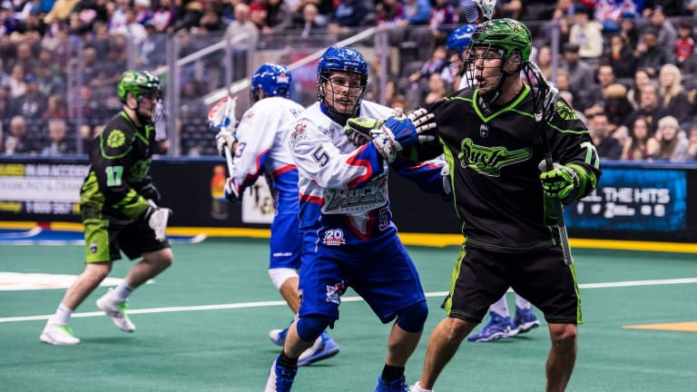 TORONTO, ON  - DEC 16,  2017: National Lacrosse League game between the Toronto Rock and the Saskatchewan Rush, Sandy Chapman battles for position against Jeff Shattler. (Photo by Ryan McCullough / NLL)