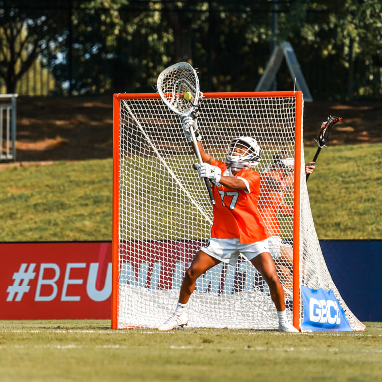 Womens pro lax - Team Benson Captain Angie Benson Making a Save - Game 1