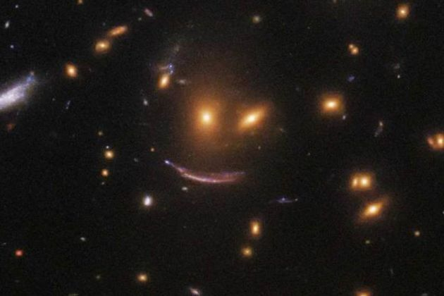 Smiling face in space