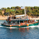 """Tourist boat on mini cruise around Thassos island, Greece"" stock image"