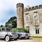 """Vintage cars outside stately home or castle"" stock image"