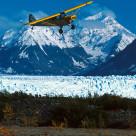 """Alaska bush plane landing at Knik Glacier Picknick Table Strip,"" stock image"