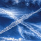 """Scottish flag made by jet vapour trails in the sky."" stock image"