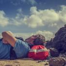 """Man resting on beach"" stock image"