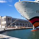 """Cruise ship with red painted lips moored at maritime station of Trieste"" stock image"