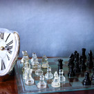 """Chessboard game and Dali-like clock"" stock image"