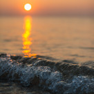 """Sunrise with waves"" stock image"