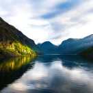 """Sunbeam over the fjord"" stock image"