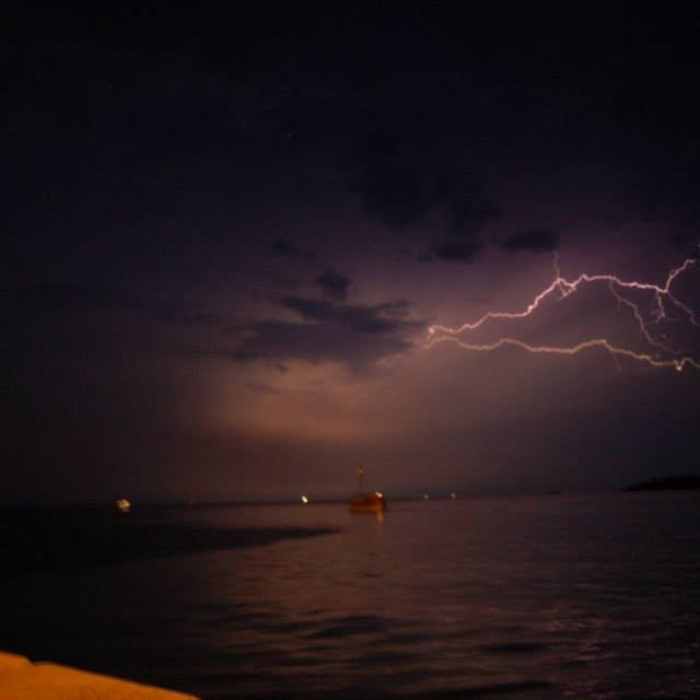 """Lightning over harbour"" stock image"