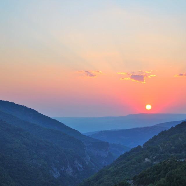 """A mountain sunset"" stock image"