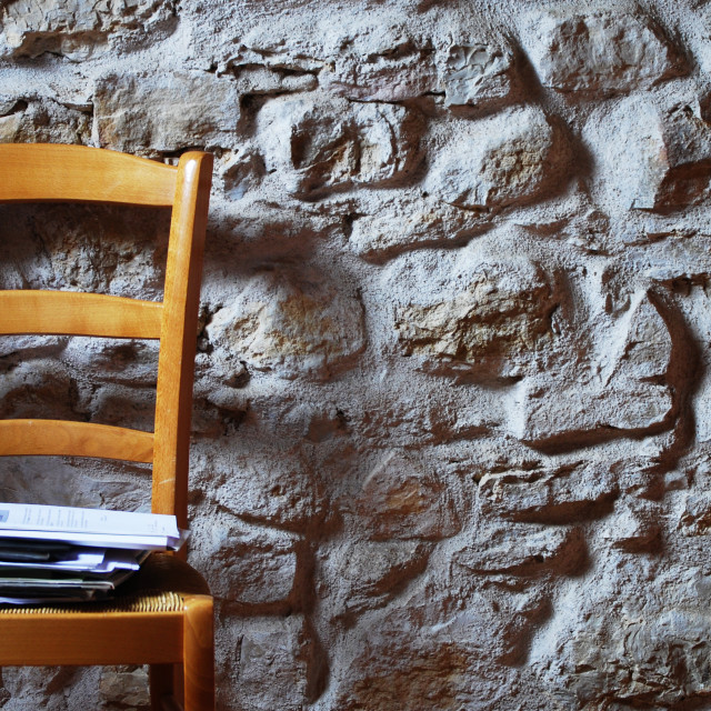 """Chair. Stone Wall."" stock image"