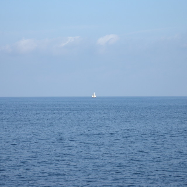 """Lone Sail Boat at Sea"" stock image"