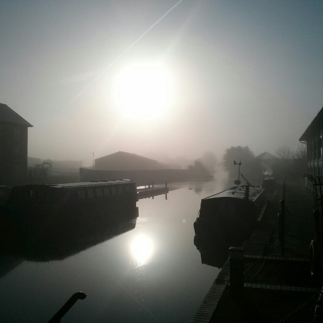 """Foggy morning over a river basin."" stock image"