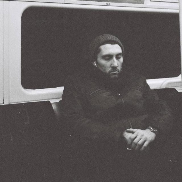 """Asleep on the Tube"" stock image"