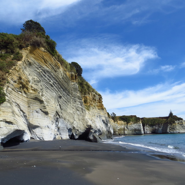 """Black sand beach & white cliffs"" stock image"
