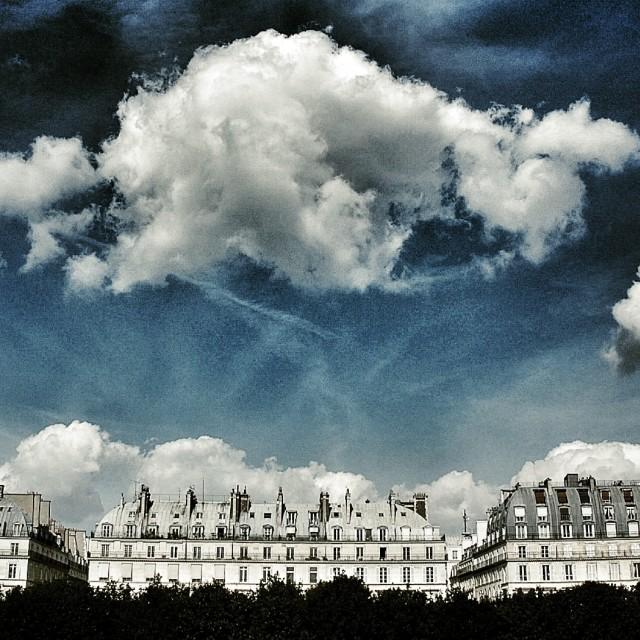 """""""Clouds over Rue de Rivoli"""" stock image"""