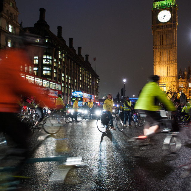 """Cyclists outside Big Ben"" stock image"
