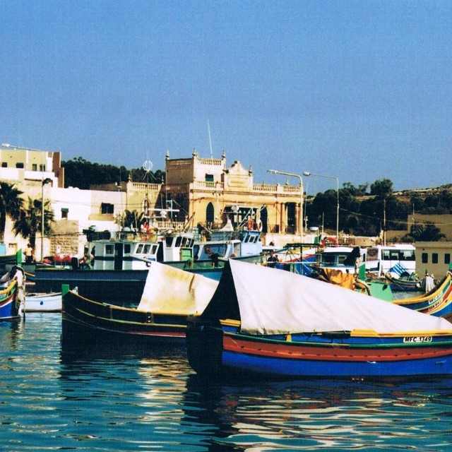"""Fishing boats in Marsaxlokk, Malta"" stock image"