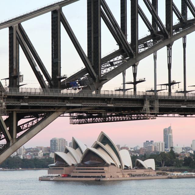 """Sydney Opera House framed by Sydney Harbour Bridge"" stock image"