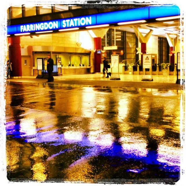 """Farringdon Underground Station in the rain"" stock image"