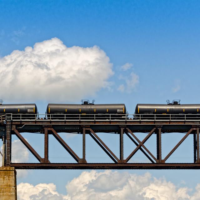 """Train cars on a bridge"" stock image"