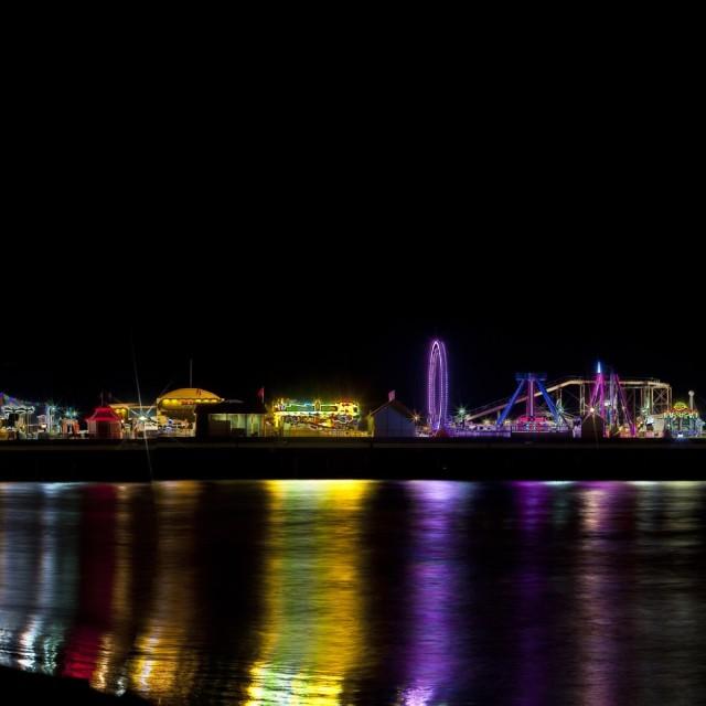 """""""Galveston pleasure pier at night"""" stock image"""