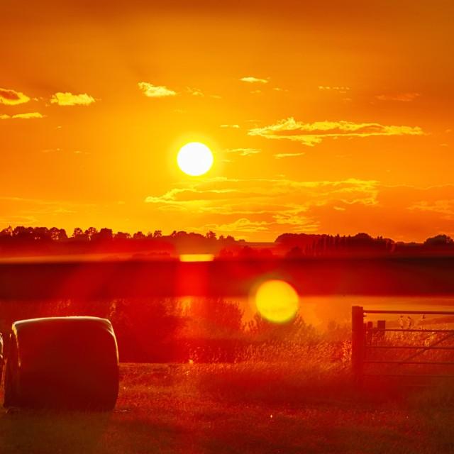 """Sunset over Oxfordshire farmland"" stock image"