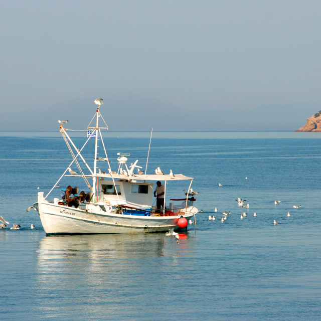"""Fishing boat in Limenaria village, Thassos island, Greece"" stock image"