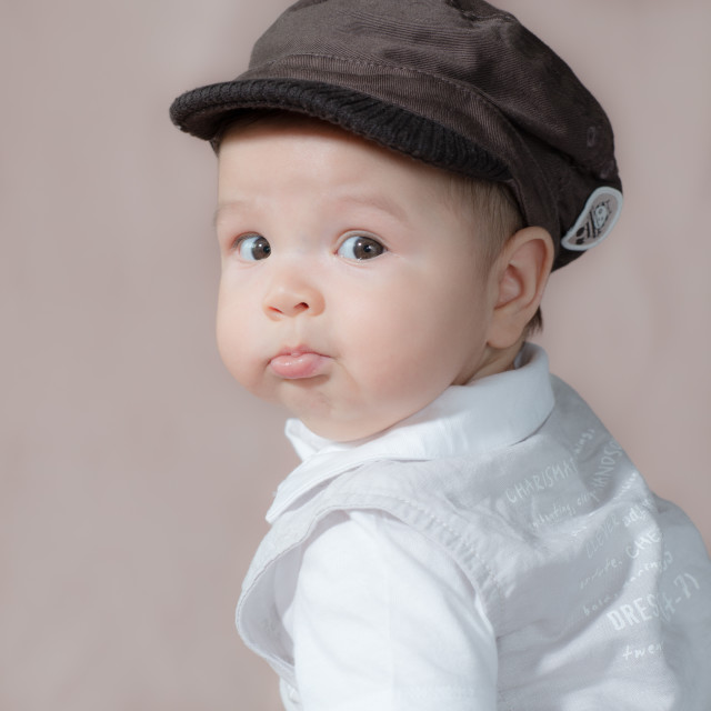 """Mixed race baby wearing hat"" stock image"