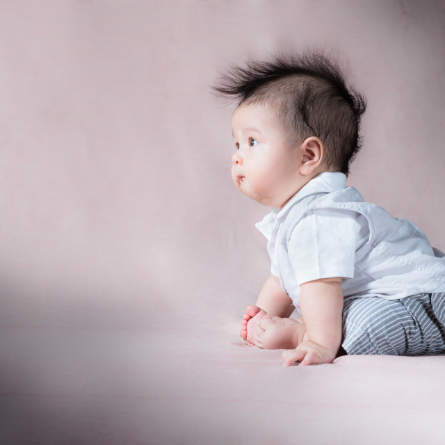 """Cute baby with funny hair"" stock image"