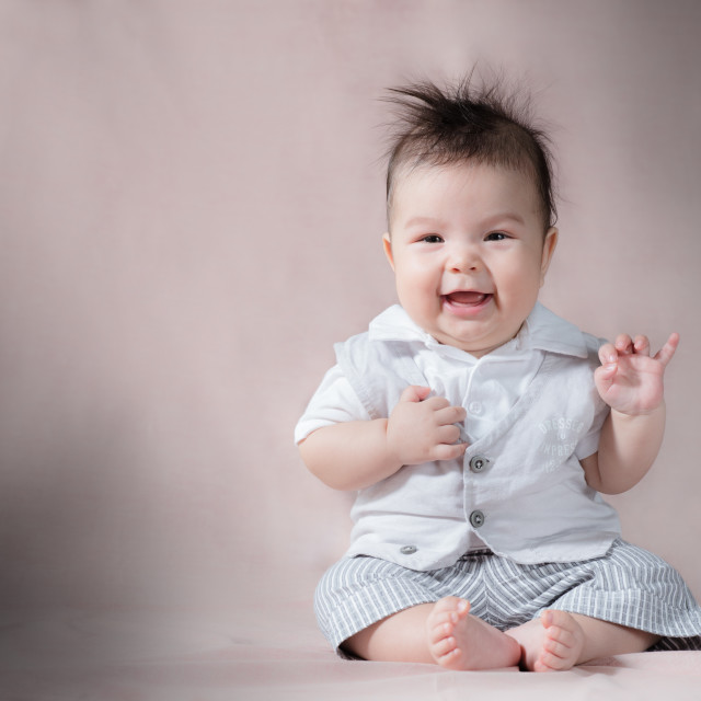 """Happy baby making funny faces"" stock image"