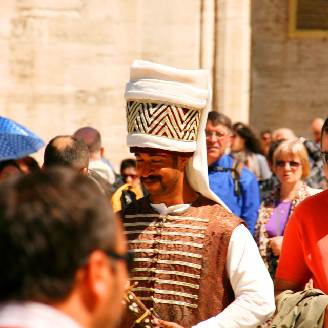 """Janissary in crowd at Topkapi Palace, Istanbul, Turkey"" stock image"