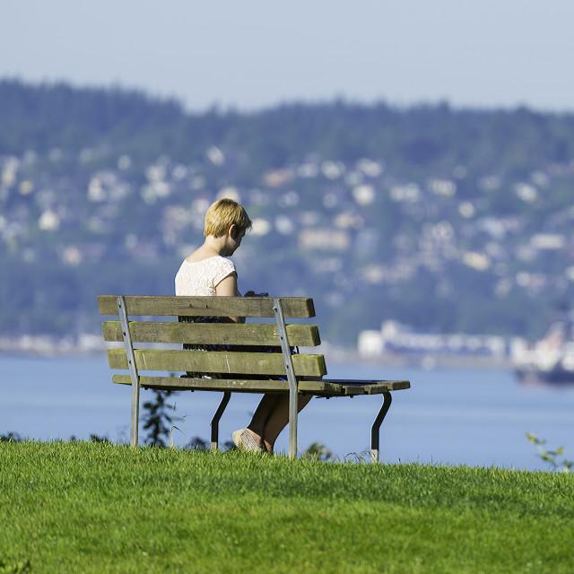 """girl readin on bench"" stock image"