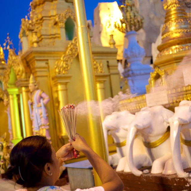 """Prayers at Shwedagon Pagoda"" stock image"