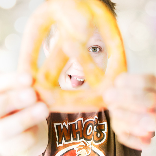 """Boy and pretzel"" stock image"