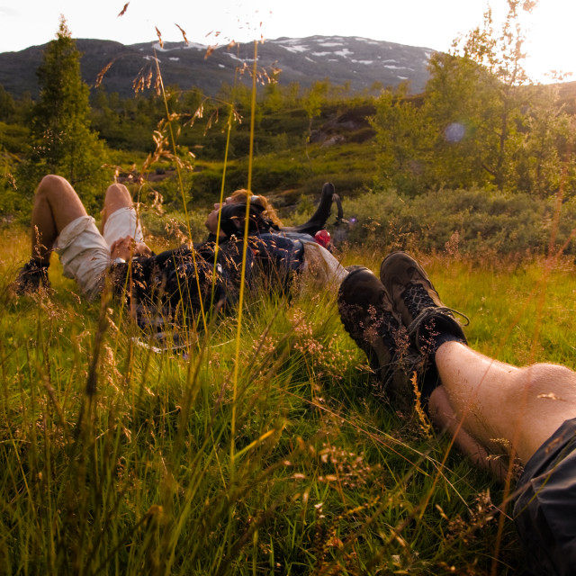 """Enjoying a break after a long hike"" stock image"