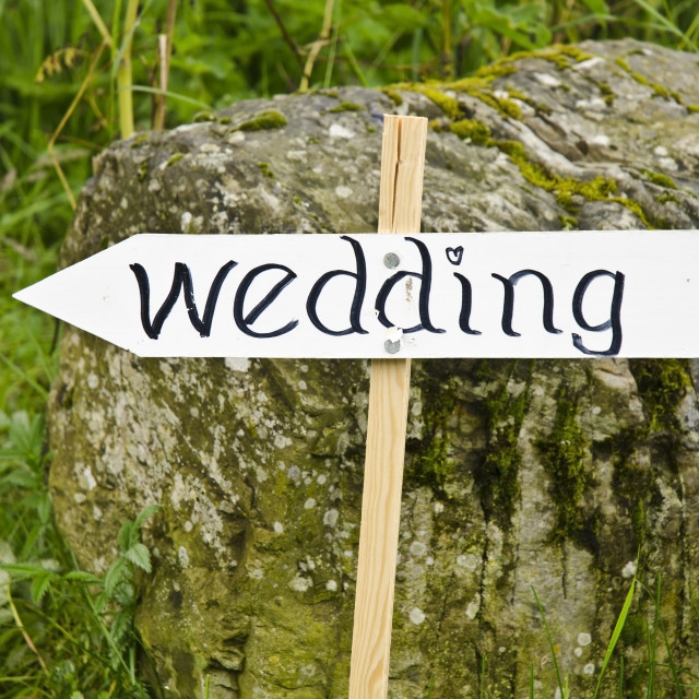 """Wedding this way"" stock image"