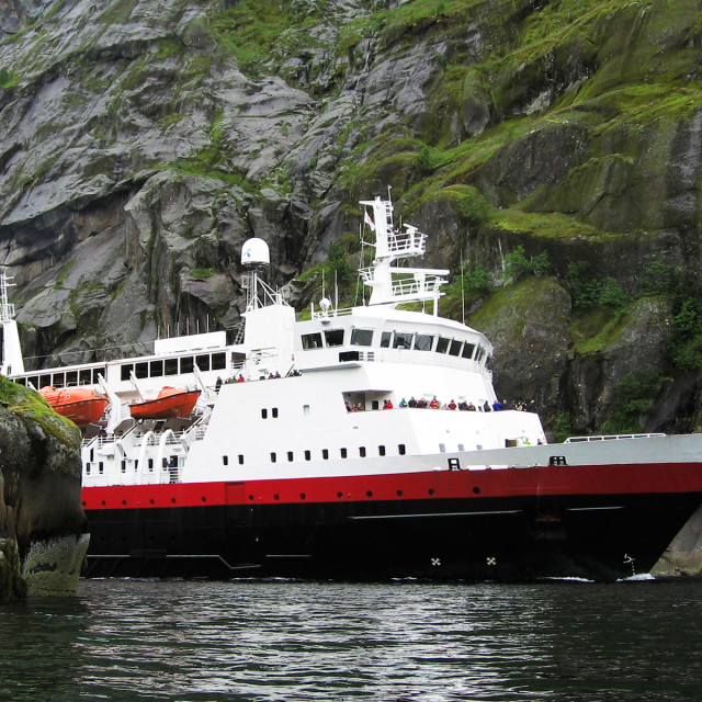 """Norwegian ferry sailing between steep cliffs of the Trollfjord, Lofoten."" stock image"