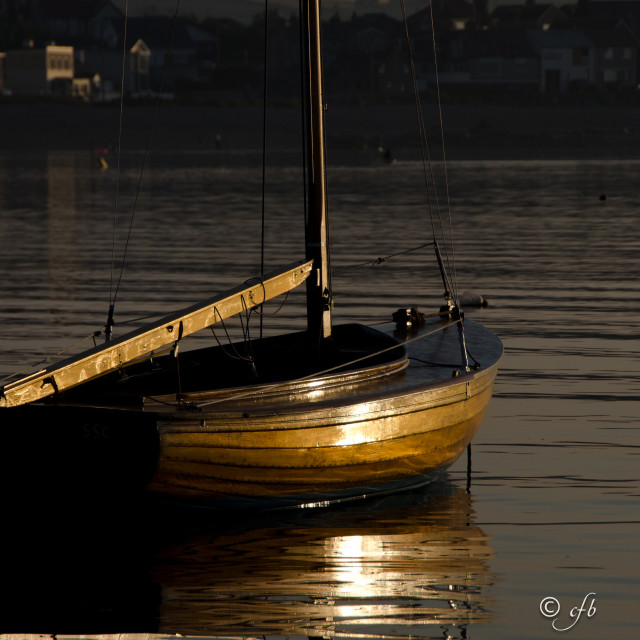 """Mermaid boat catching the light"" stock image"