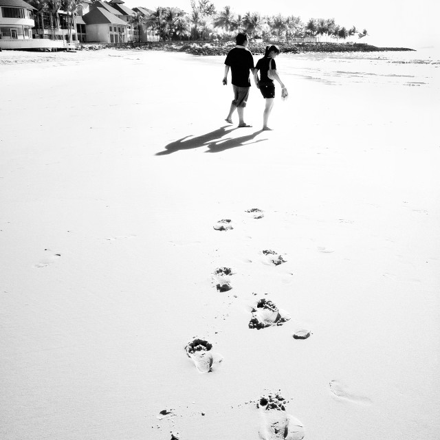 """Couple walking on the beach"" stock image"