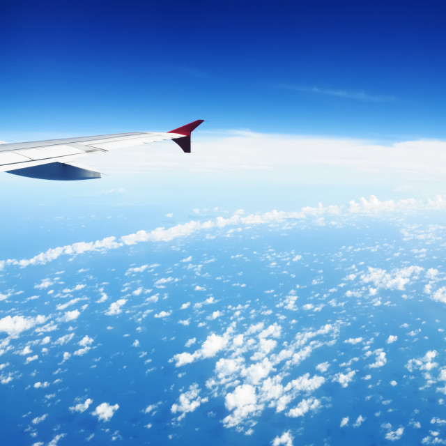 """Airplane Wing Against Blue Sky"" stock image"