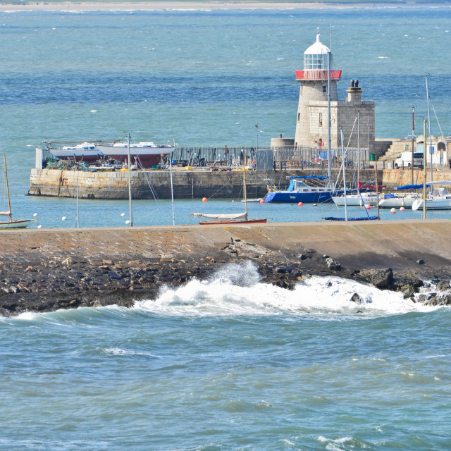"""Howth Harbour and Lighthouse"" stock image"