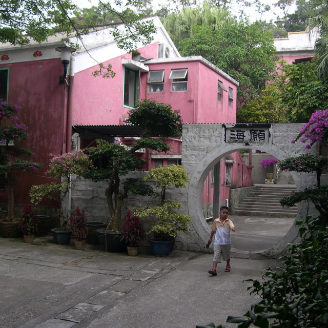 """Boy and pink house on Lantau Island"" stock image"