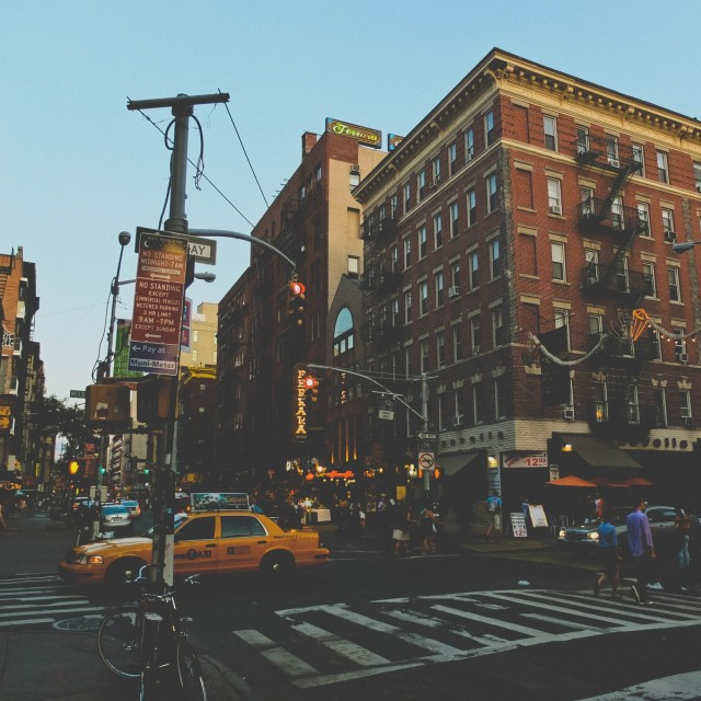 """Yellow cab passing through Little Italy"" stock image"