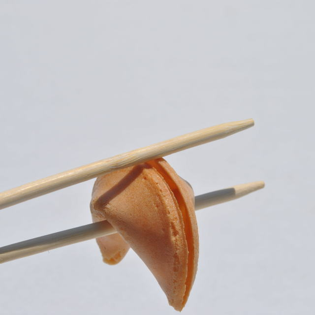 """fortune cookie held by chopsticks"" stock image"