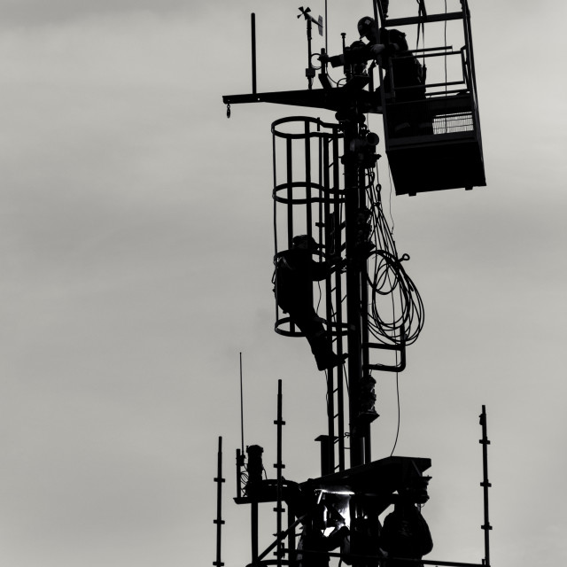 """Workers on a mast"" stock image"