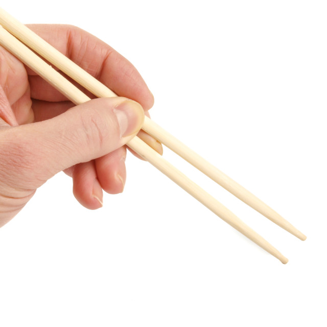 """Eating with chopsticks"" stock image"