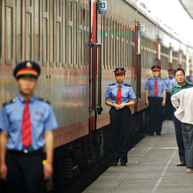 """Chinese train conductors"" stock image"